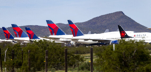 Passenger jets from Delta Airlines lined up for storage at Pinal Airpark in Pinal County, north of Tucson, Ariz., on March 16, 2020. (Rebecca Sasnett/Arizona Daily Star)