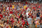 Fans are asked to leave the stadium after lightning was spotted during as Iowa State takes on South Dakota State in an NCAA college football game, Saturday, Sept. 1, 2018, in Ames, Iowa. (AP Photo/Matthew Putney)