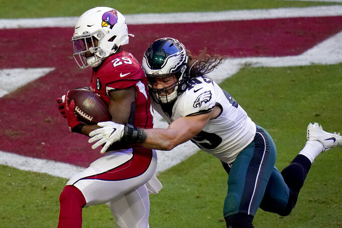 Arizona Cardinals running back Chase Edmonds (29) scores a touchdown as Philadelphia Eagles linebacker Alex Singleton defends during the first half of an NFL football game, Sunday, Dec. 20, 2020, in Glendale, Ariz. (AP Photo/Ross D. Franklin)