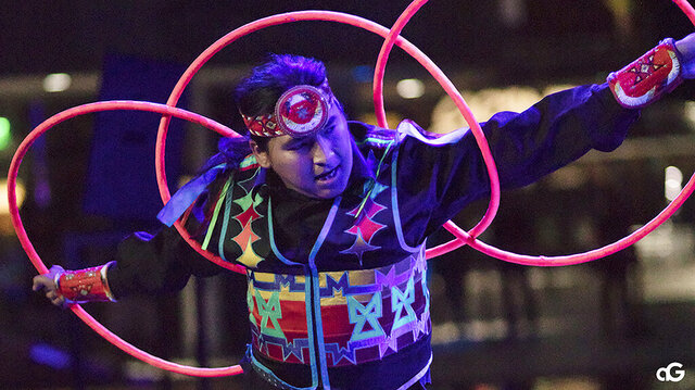 In this Aug. 10, 2018, photo provided by Anderson Gould Jr. hoop dancer Nakotah LaRance performs at the