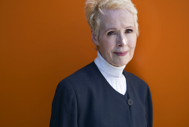 FILE - In this June 23, 2019, file photo, E. Jean Carroll poses for a photo in New York. Lawyers for Carroll, who has accused President Donald Trump of raping her in the 1990s, told a court Tuesday, Feb. 18, 2020 he's trying
