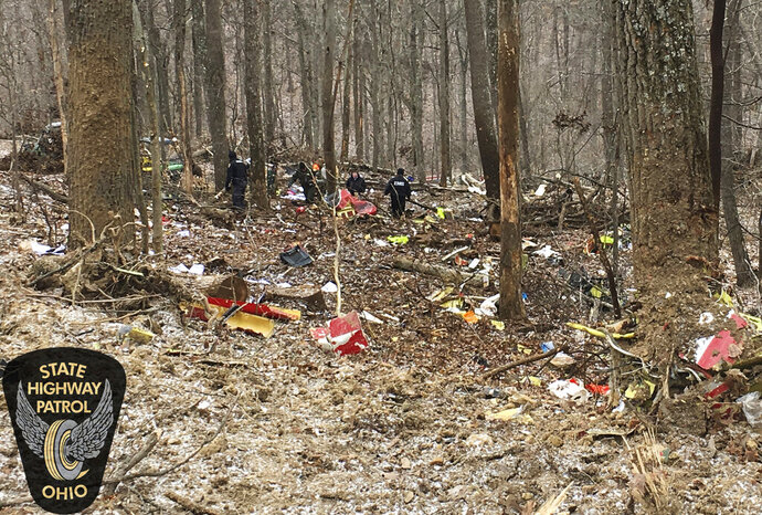 FILE - In this Jan. 29, 2019 file photo provided by the Ohio State Highway Patrol, authorities survey the scene of wreckage where a medical helicopter crashed in a remote wooded area in Brown Township, Ohio, on its way to pick up a patient. A preliminary report released Monday, Feb. 11 from the National Transportation Safety Board said the helicopter made
