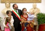 """FILE -- In this  Oct. 18, 2014 file photo Rome's Mayor Ignazio Marino, center, is flanked by Costanza Tantillo, left, and Monia Di Giuseppe, right, after he registered their gay marriage, in Rome. The Vatican has decreed, Monday, March 15, 2021, that the Catholic Church cannot bless same-sex unions since God """"cannot bless sin."""" The Vatican's orthodoxy office, the Congregation for the Doctrine of the Faith, issued a formal response to a question about whether Catholic clergy can bless gay unions. (AP Photo/Andrew Medichini)"""