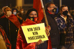 A protestor holds a banner reading in Macedonian