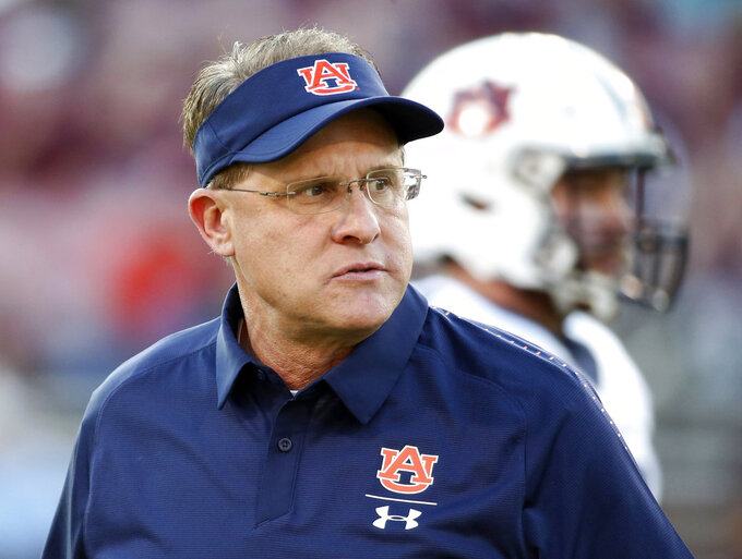 FILE - In this Oct. 6, 2018, file photo, Auburn coach Gus Malzahn watches players warm up before an NCAA college football game against Mississippi State in Starkville, Miss. The Tigers visit Georgia this week and, of course, finish with 'Bama in the Iron Bowl on Nov. 24. (AP Photo/Rogelio V. Solis, File)