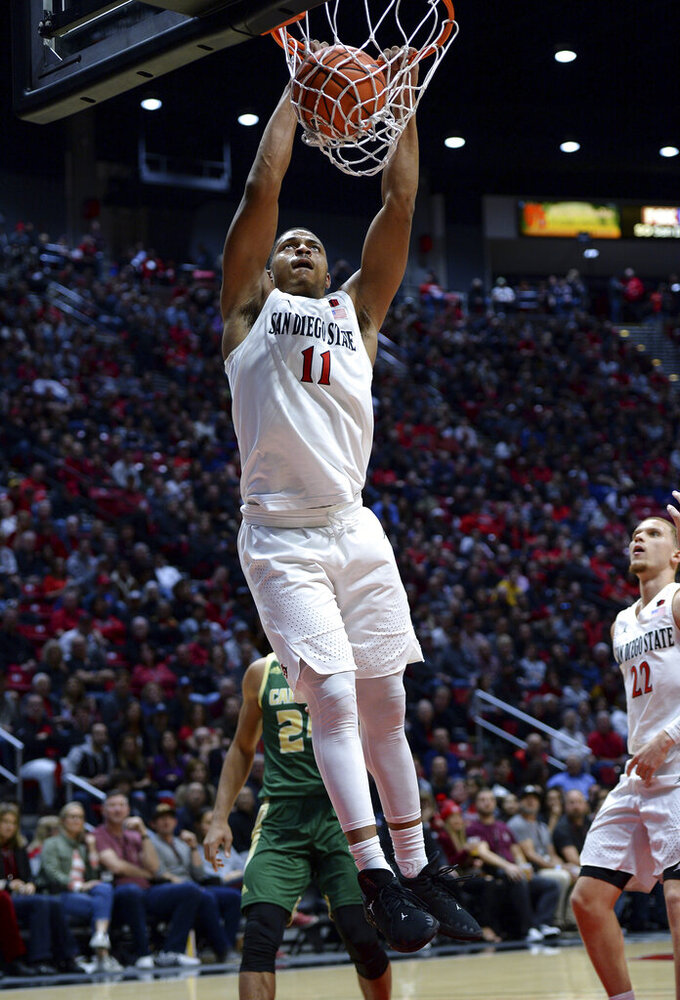 San Diego State forward Matt Mitchell dunks during the first half of the team's NCAA college basketball game against Cal Poly on Saturday, Dec. 28, 2019, in San Diego. (AP Photo/Orlando Ramirez)