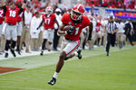 Georgia wide receiver Arian Smith (11) runs in for a touchdown after a catch during the first half of an NCAA college football game against UAB, Saturday, Sept. 11, 2021, in Athens, Ga. (AP Photo/John Bazemore)