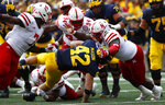 Michigan fullback Ben Mason (42) is brought down by Nebraska defensive lineman Carlos Davis (96) in the first half of an NCAA football game in Ann Arbor, Mich., Saturday, Sept. 22, 2018. (AP Photo/Paul Sancya)