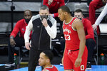 Ohio State head coach Chris Holtmann talks with Zed Key during the first half of an NCAA college basketball championship game against Illinois at the Big Ten Conference tournament, Sunday, March 14, 2021, in Indianapolis. (AP Photo/Darron Cummings)