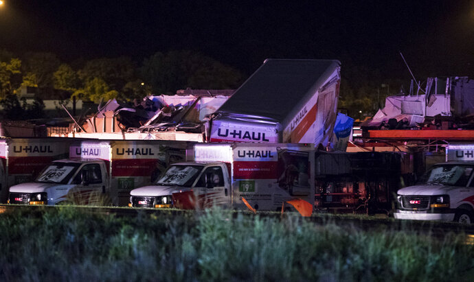 U-Haul trucks parked on Mundy Street in Wilkes-Barre Township, Pa., are damaged after a strong storm moved through the area on Wednesday, June 13, 2018. A powerful storm has pounded parts of Pennsylvania, damaging buildings, overturning cars and downing trees and power lines.  (Christopher Dolan/The Citizens' Voice via AP)