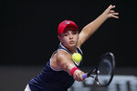 Ashleigh Barty of Australia hits a return shot against Kiki Bertens of the Netherlands during their WTA Finals Tennis Tournament in Shenzhen, China's Guangdong province, Tuesday, Oct. 29, 2019. (AP Photo/Andy Wong)