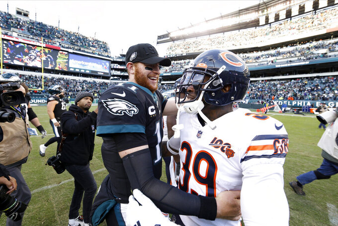 Philadelphia Eagles' Carson Wentz, left, and Chicago Bears' Eddie Jackson (39) meet after an NFL football game, Sunday, Nov. 3, 2019, in Philadelphia. (AP Photo/Chris Szagola)
