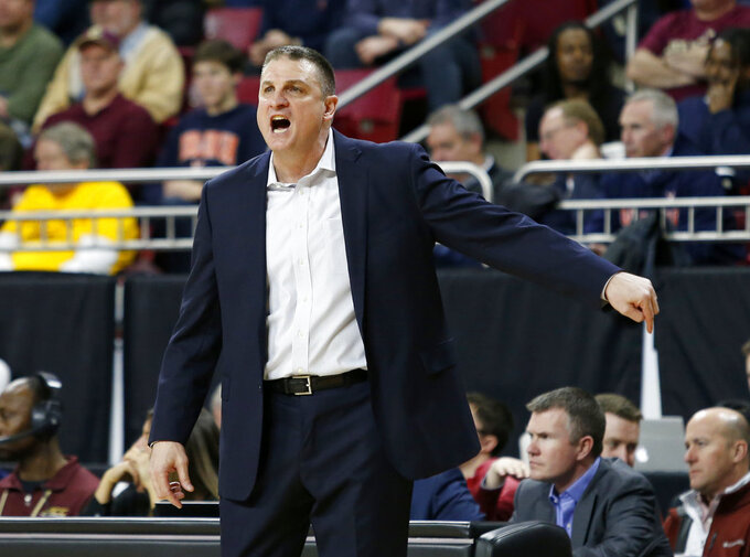 Boston College coach Jim Christian directs his team during the first half of an NCAA basketball game against Virginia on Wednesday, Jan. 9, 2019, in Boston. (AP Photo/Mary Schwalm)