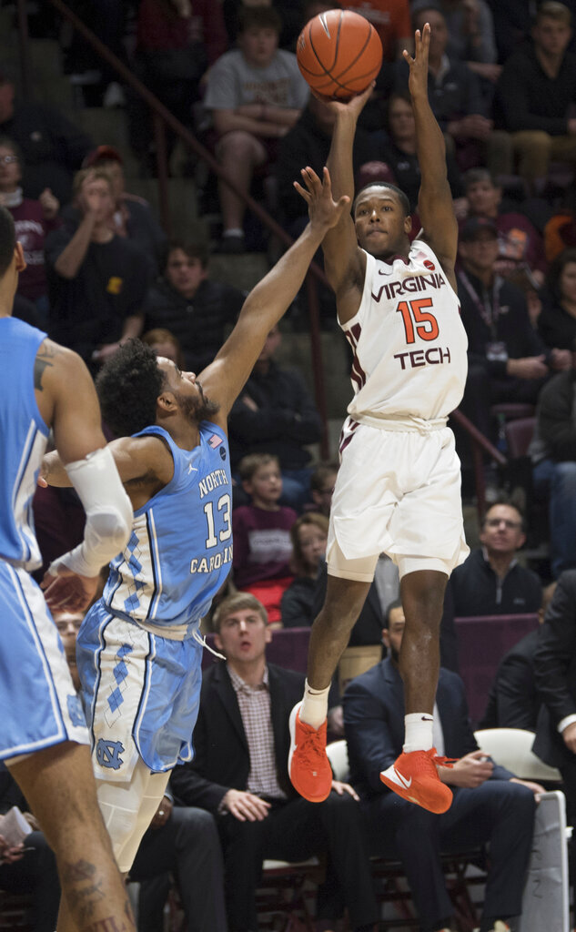 Virginia Tech guard Jalen Cone (15) shoots over North Carolina defender Jeremiah Francis (13) during the second half of an NCAA college basketball game in Blacksburg, Va., Wednesday, Jan. 22, 2020.(AP Photo/Lee Luther Jr.)