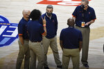 Virginia head coach Tony Bennett, center, meets with his coaching staff during a time out in the first half of an NCAA college basketball game against Towson, Wednesday, Nov. 25, 2020, in Uncasville, Conn. (AP Photo/Jessica Hill)