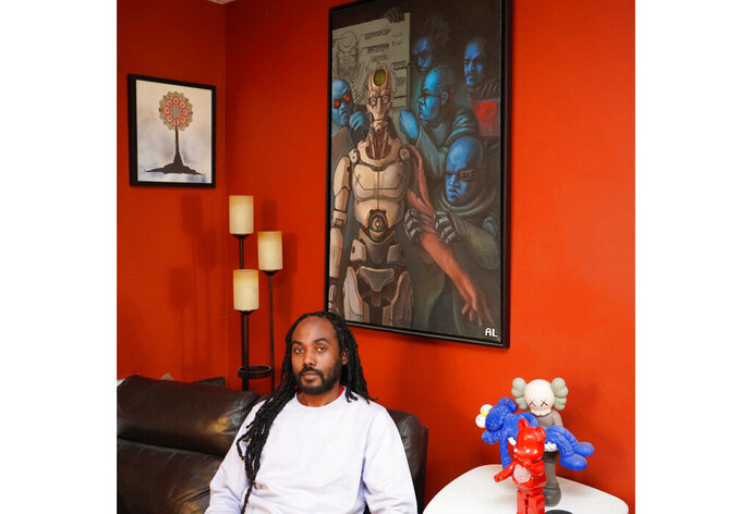 Atiba T. Edwards appears in his apartment in the Brooklyn borough of New York on Monday, Feb. 22, 2021. Edwards is the cofounder of the arts nonprofit FOKUS, which offers arts education, hosts art events and publishes an online magazine. (Atiba Edwards via AP)