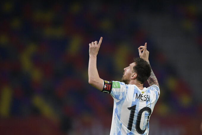 Argentina's Lionel Messi celebrates scoring his side's opening goal on a penalty kick during a qualifying soccer match against Chile for the FIFA World Cup Qatar 2022 in Santiago del Estero, Argentina, Thursday, June 3, 2021. (Juan Mabromata, Pool via AP)