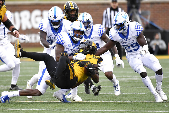Missouri running back Larry Rountree III (34) is stopped by a host of Kentucky defenders during the second half of an NCAA college football game Saturday, Oct. 24, 2020, in Columbia, Mo. (AP Photo/L.G. Patterson)