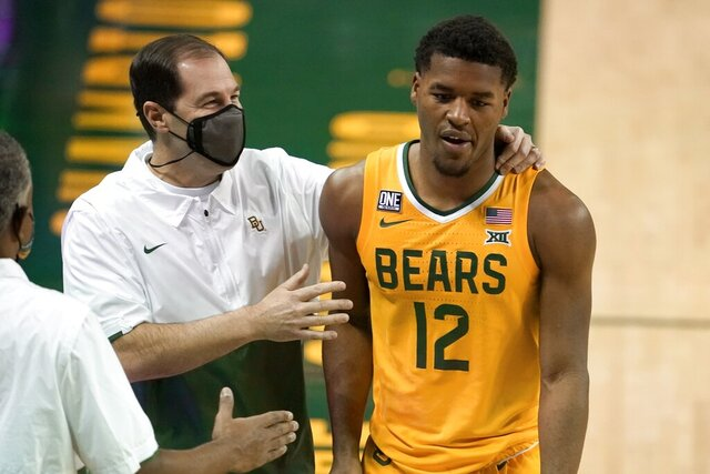 Baylor head coach Scott Drew, left, talks with guard Jared Butler (12) as he leaves the game late in the second half of an NCAA college basketball game against Stephen F. Austin in Waco, Texas, Wednesday, Dec. 9, 2020. (AP Photo/Tony Gutierrez)
