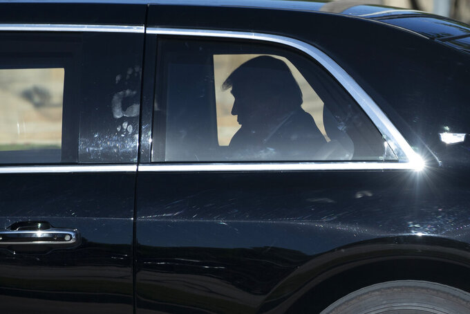 """FILE - In this June 11, 2020, file photo President Donald Trump rides in his limousine as he departs after speaking during a roundtable discussion about """"Transition to Greatness: Restoring, Rebuilding, and Renewing,"""" at Gateway Church Dallas in Dallas. (AP Photo/Alex Brandon, File)"""