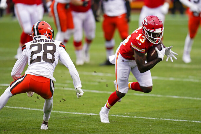 Kansas City Chiefs wide receiver Byron Pringle (13) runs from Cleveland Browns cornerback Kevin Johnson (28) after catching a pass during the first half of an NFL divisional round football game, Sunday, Jan. 17, 2021, in Kansas City. (AP Photo/Jeff Roberson)