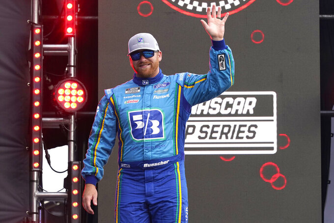Chris Buescher waves to fans during driver introductions before the NASCAR Cup Series auto race at Daytona International Speedway, Saturday, Aug. 28, 2021, in Daytona Beach, Fla. (AP Photo/John Raoux)