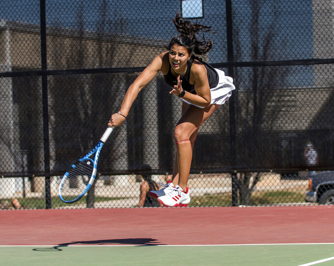 In this undated photo provided by Southern Utah Athletics, Ghita Nassik hits the ball during tennis practice at Southern Utah University in Cedar City, Utah. Southern Utah announced June 23, 2020, it was eliminating its men's and women's tennis programs effective immediately due to budget cuts brought on by the coronavirus pandemic. (Joey DeGraaf/Southern Utah Athletics  via AP)