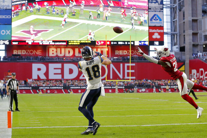 Los Angeles Rams wide receiver Cooper Kupp (18) pulls in a touchdown catch against the Arizona Cardinals during the second half of an NFL football game, Sunday, Dec. 1, 2019, in Glendale, Ariz. (AP Photo/Rick Scuteri)