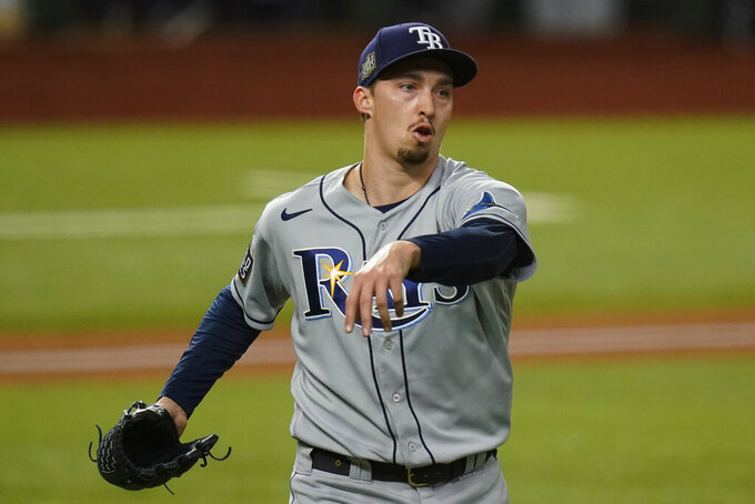 "FILE - Tampa Bay Rays starting pitcher Blake Snell celebrates the end of the fifth inning against the Los Angeles Dodgers in Game 6 of the baseball World Series in Arlington, Texas, in this Tuesday, Oct. 27, 2020, file photo. With baseball trying to negotiate a comeback and unemployment battering the country, star Tampa Bay pitcher Blake Snell took a less than diplomatic approach: ""I'm not splitting no revenue,"" he said. ""I want all mine."" (AP Photo/Eric Gay, File)"