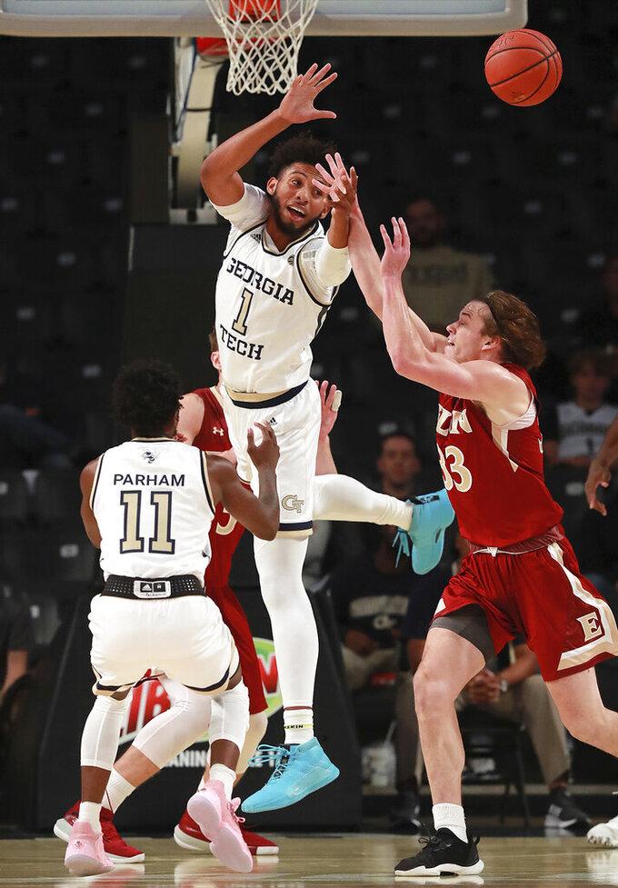 Georgia Tech forward James Banks III (1) blocks a shot by Elon forward Simon Wright during the first half of an NCAA college basketball game on Monday, Nov. 11, 2019, in Atlanta. Georgia Tech won, 64-41. (Curtis Compton/Atlanta Journal-Constitution via AP)