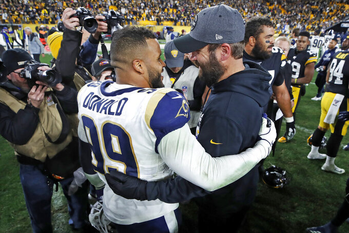 Pittsburgh Steelers quarterback Ben Roethlisberger, right, and Los Angeles Rams defensive tackle Aaron Donald (99) visit on the field following an NFL football game in Pittsburgh, Sunday, Nov. 10, 2019. The Steelers won 17-12. (AP Photo/Don Wright)
