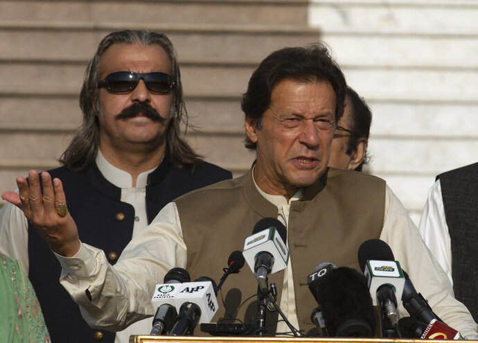Pakistani Prime Minister Imran Khan addresses a Kashmir rally in Islamabad, Pakistan, Friday, Oct. 11, 2019. Pakistan's foreign minister says Prime Minister Imran Khan will travel to Iran's capital Saturday before traveling on to Saudi Arabia as part of his efforts to ease tensions between the two Islamic countries. (AP Photo/B.K. Bangash)