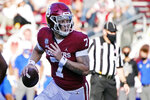 FIL - In this Nov. 7, 2020, file photo, Oklahoma quarterback Spencer Rattler (7) carries for a touchdown in the first half of an NCAA college football game against Kansas in Norman, Okla. (AP Photo/Sue Ogrocki, File)