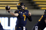 FILE - In this Dec. 5, 2020, file photo, California quarterback Chase Garbers throws a pass against Oregon during the second half of an NCAA college football game in Berkeley, Calif. After a pandemic-shortened 2020 season, the California Golden Bears are excited to show off what they hope will be a much more dynamic offense with respected longtime NFL coordinator Bill Musgrave and veteran quarterback Chase Garbers. (AP Photo/Jeff Chiu, File)