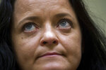 Suspect Beate Zschaepe arrives for the verdict in the court in Munich, southern Germany, Wednesday, July 11, 2018.  The court found the main defendant in the high-profile neo-Nazi trial guilty over the killing of 10 people _ most of them migrants _ who were gunned down between 2000 and 2007 in a case that shocked Germany and prompted accusations of institutional racism against the country's security agencies. (Peter Kneffel/pool photo via AP)