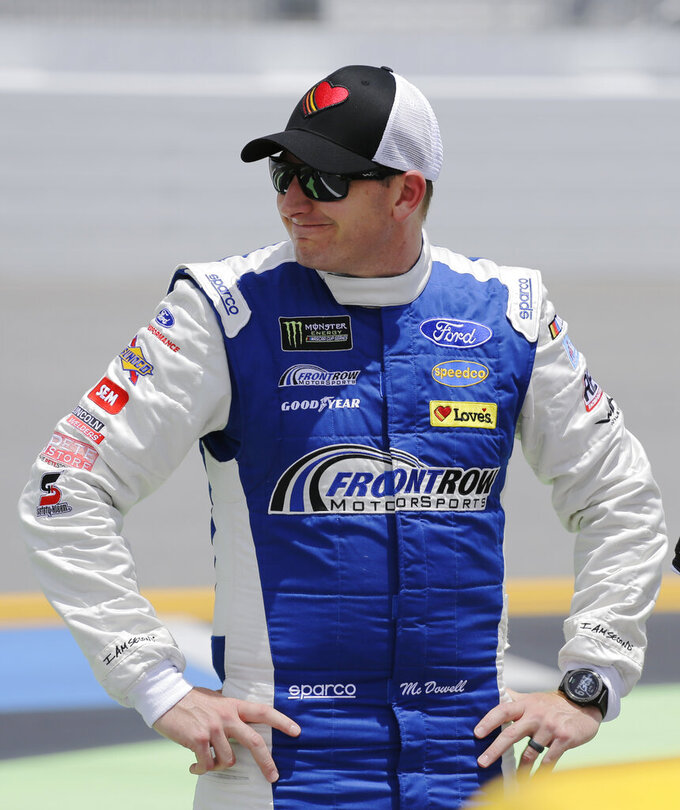 Michael McDowell stands on pit road before a NASCAR auto race at Daytona International Speedway on Sunday, July 7, 2019, in Daytona Beach, Fla. (AP Photo/Terry Renna)
