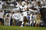 Auburn cornerback Roger McCreary (23) intercepts a pass intended for Penn State wide receiver KeAndre Lambert-Smith during the first half of an NCAA college football game in State College, Pa., on Saturday, Sept. 18, 2021. (AP Photo/Barry Reeger)