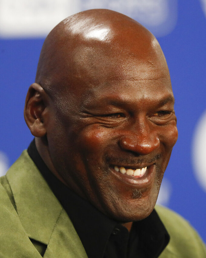 """FILE - In this Jan. 24, 2020 file photo, former basketball superstar Michael Jordan speaks during a news conference ahead of NBA basketball game between Charlotte Hornets and Milwaukee Bucks in Paris. 23XI Racing announced a full slate of sponsorship Monday, Dec. 14, 2020, to back the new NASCAR team owned by Michael Jordan and Denny Hamlin.  DoorDash, McDonald's, Columbia Sportswear, Dr Pepper and Root Insurance were all named """"founding partners"""" for the No. 23 Toyota Camry that Bubba Wallace will drive next season. (AP Photo/Thibault Camus, File)"""