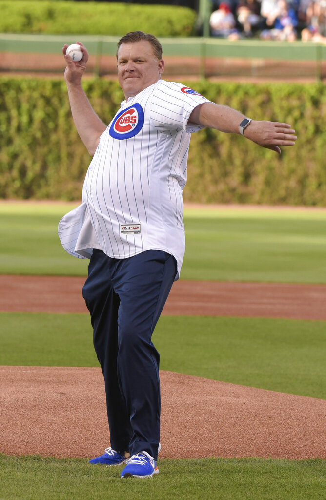 Illinois men's basketball coach Brad Underwood tosses out the ceremonial first pitch before the a baseball game between the Chicago Cubs and Philadelphia Phillies on Wednesday, May 22, 2019, in Chicago. (AP Photo/Mark Black)