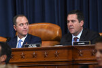 Chairman of the House Intelligence Committee Adam Schiff, D-Calif., left, listens as ranking member Rep. Devin Nunes, R-Calif., questions former U.S. Ambassador to Ukraine Marie Yovanovitch at the House Intelligence Committee on Capitol Hill in Washington, Friday, Nov. 15, 2019, in the second public impeachment hearing of President Donald Trump's efforts to tie U.S. aid for Ukraine to investigations of his political opponents. (AP Photo/Susan Walsh)