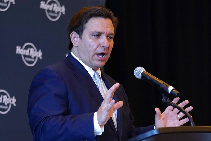 Florida Gov. Ron DeSantis speaks during a news conference, Monday, Aug. 24, 2020, at Hard Rock Stadium in Miami Gardens, Fla. The Miami Dolphins NFL football team have decided to allow up to 13,000 socially distancing fans to attend their home opener against the Buffalo Bills on Sept 20, with the approval of state and local political leaders. (AP Photo/Lynne Sladky)