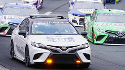 New England Patriots wide receiver Gunner Olszewski drives the pace car prior to a NASCAR Cup Series auto race, Sunday, July 18, 2021, in Loudon, N.H. (AP Photo/Charles Krupa)