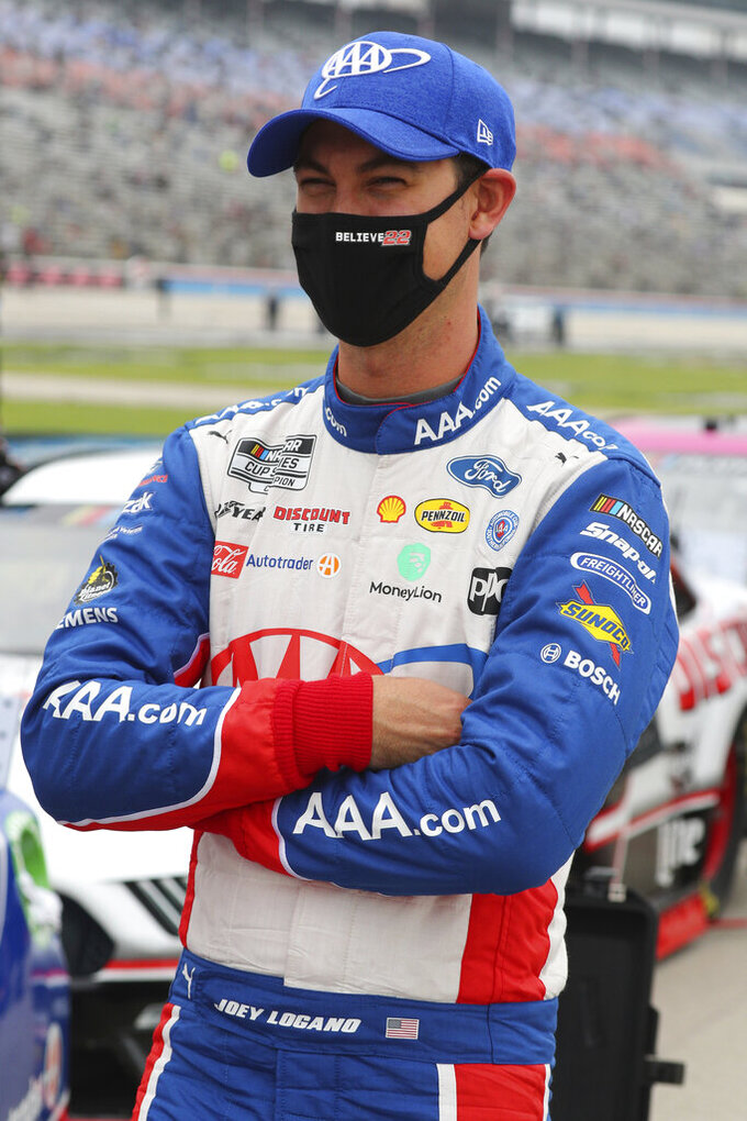Joey Logano (22) waits on the grid before a NASCAR Cup Series auto race at Texas Motor Speedway in Fort Worth, Texas, Sunday, Oct. 25, 2020. (AP Photo/Richard W. Rodriguez)