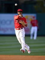 Los Angeles Angels second baseman Luis Rengifo throws out Texas Rangers' Nomar Mazara at first during the first inning of a baseball game Friday, May 24, 2019, in Anaheim, Calif. (AP Photo/Mark J. Terrill)