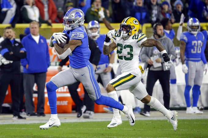 Detroit Lions wide receiver Kenny Golladay, left, runs after making a catch while covered by Green Bay Packers cornerback Jaire Alexander during the first half of an NFL football game Monday, Oct. 14, 2019, in Green Bay, Wis. (AP Photo/Mike Roemer)