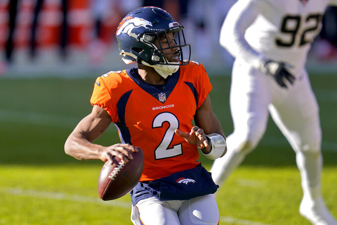 Denver Broncos quarterback Kendall Hinton (2) looks to throw against the New Orleans Saints during the first half of an NFL football game, Sunday, Nov. 29, 2020, in Denver. (AP Photo/David Zalubowski)