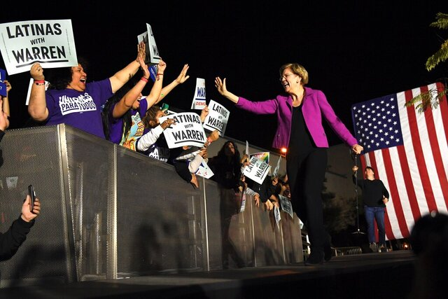 Democratic presidential candidate Sen. Elizabeth Warren, D-Mass., takes the stage before speaking to supporters, Monday, March 2, 2020, in the Monterey Park section of Los Angeles. (AP Photo/Mark J. Terrill)