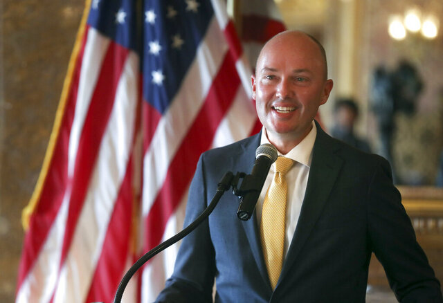 Utah Gov.-elect Spencer Cox announces details related to the upcoming transition of leadership in the Gold Room at the Utah State Capitol on Thursday, Nov. 5, 2020, in Salt Lake City. Cox, who won the governor's race this week, said he is prepared to continue the fight against COVID-19 when he succeeds Herbert in January. He said he hopes to focus on ramping up testing, adding more contact tracers and implementing vaccine distribution. (Steve Griffin/Deseret News, via AP, Pool)