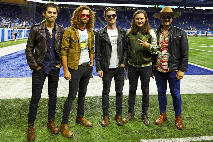 "FILE - This Sept. 10, 2018 file photo shows members of the band LANCO on the field before a NFL football game between the Detroit Lions and the New York Jets in Detroit. The Academy of Country Music named LANCO as best new group of the year.  The group of five released their first album ""Hallelujah Nights"" last year on Arista Nashville. (AP Photo/Rick Osentoski, File)"
