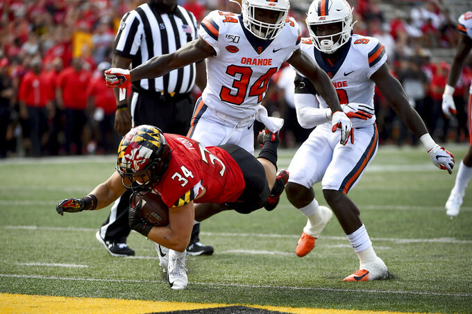 Maryland running back Jake Funk (34) dives for a touchdown in front of Syracuse defensive back Eric Coley (34) during the second half of an NCAA college football game, Saturday, Sept. 7, 2019, in College Park, Md. (AP Photo/Will Newton)